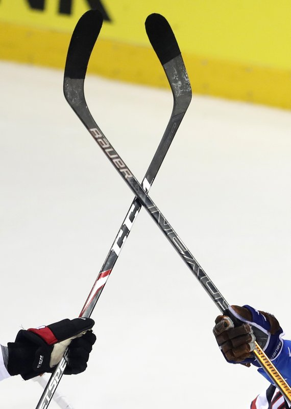 Finland's Niko Ojamaki, right, challenges Canada's Thomas Chabot, left, during the Ice Hockey World Championships group A match between Finland and Canada at the Steel Arena in Kosice, Slovakia, Friday, May 10, 2019. (AP Photo/Petr David Josek)