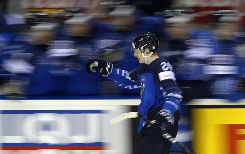 Finland's Kaapo Kakko celebrates after scoring his sides third goal during the Ice Hockey World Championships group A match between Finland and Canada at the Steel Arena in Kosice, Slovakia, Friday, May 10, 2019. (AP Photo/Petr David Josek)
