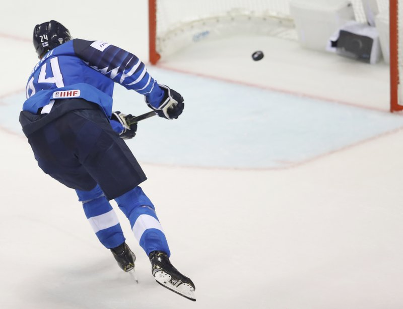 Finland's Kaapo Kakko scores his sides third goal during the Ice Hockey World Championships group A match between Finland and Canada at the Steel Arena in Kosice, Slovakia, Friday, May 10, 2019. (AP Photo/Petr David Josek)