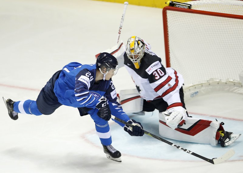 Finland's Kaapo Kakko, left, scores his sides first goal past Canada's goaltender Matt Murray, right, during the Ice Hockey World Championships group A match between Finland and Canada at the Steel Arena in Kosice, Slovakia, Friday, May 10, 2019. (AP Photo/Petr David Josek)