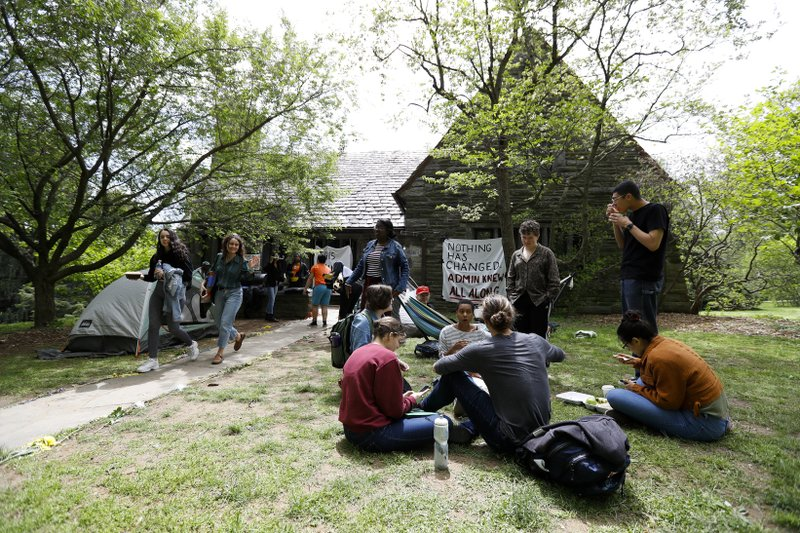 FILE - In this April 29, 2019, file photo, Swarthmore College students gather outside the Phi Psi fraternity house during a sit-in, in Swarthmore, Pa. (AP Photo, File)