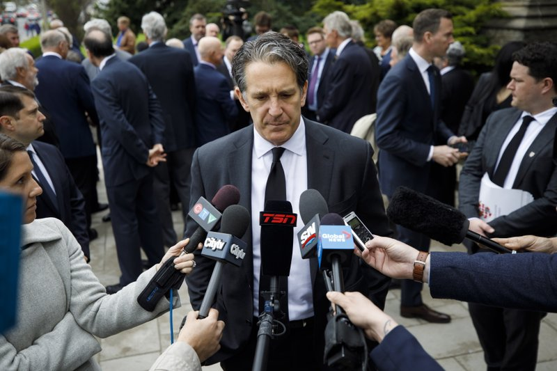 Toronto Maple Leafs president Brendan Shanahan speaks to the media following the funeral Mass for NHL legend Leonard Patrick