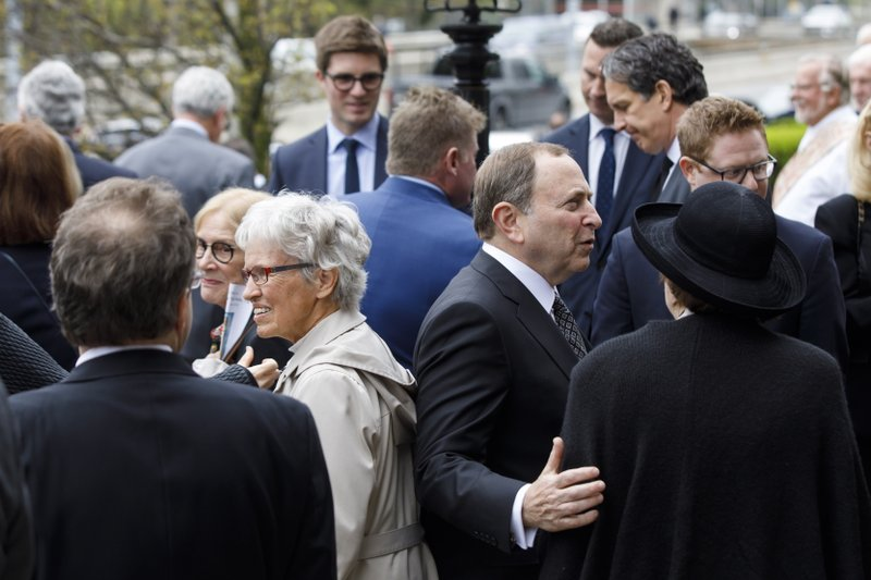 NHL commissioner Gary Bettman, center right, greets mourners following the funeral Mass for NHL legend Leonard Patrick