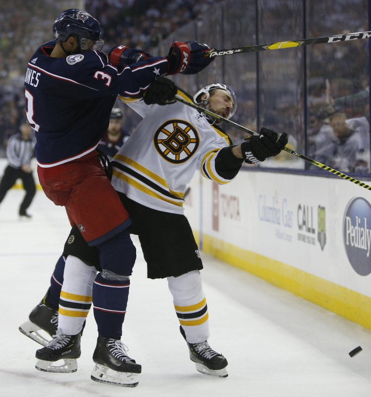 Columbus Blue Jackets' Seth Jones, left, checks Boston Bruins' Brad Marchand during the third period of Game 3 of an NHL hockey second-round playoff series Tuesday, April 30, 2019, in Columbus, Ohio. (AP Photo/Jay LaPrete)