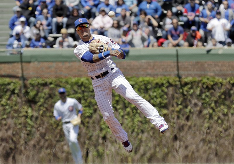 Chicago Cubs shortstop Javier Baez throws out Milwaukee Brewers' Ryan Braun at first during the first inning of a baseball game Friday, May 10, 2019, in Chicago. (AP Photo/Nam Y. Huh)