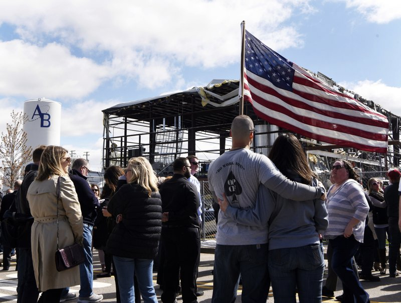 Attendees listen during a memorial, Friday morning, May 10, 2019, in Waukegan, Ill. , for the victims of a recent explosion at the AB Specialty Silicones plant. (Joe Lewnard/Daily Herald via AP)