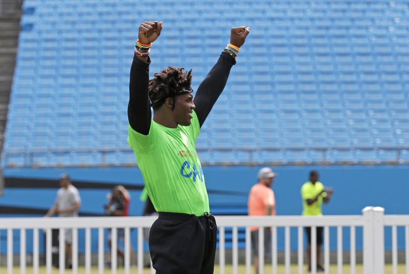 Carolina Panthers Cam Newton celebrates an out during his charity kickball tournament in Charlotte, N. (AP Photo/Chuck Burton)