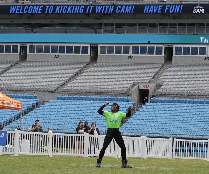 Carolina Panthers Cam Newton dances in the outfield during his charity kickball tournament in Charlotte, N. (AP Photo/Chuck Burton)