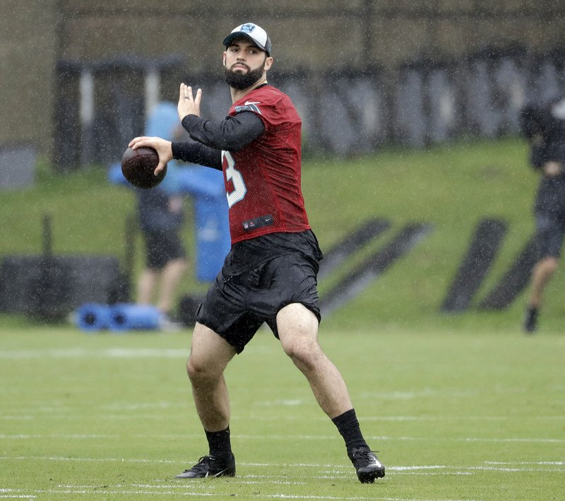 Carolina Panthers rookie quarterback Will Grier (3) looks to pass during the NFL football team's rookie camp in Charlotte, N. (AP Photo/Chuck Burton)