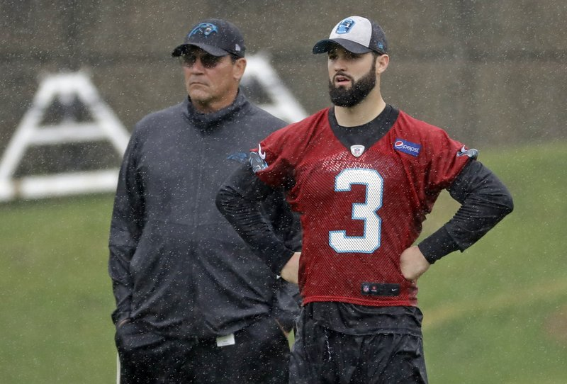 Carolina Panthers rookie quarterback Will Grier (3) stands with head coach Ron Rivera, left, during the NFL football team's rookie camp in Charlotte, N. (AP Photo/Chuck Burton)