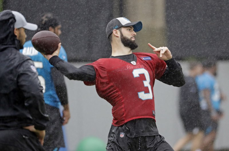Carolina Panthers rookie quarterback Will Grier (3) throws a pass during the NFL football team's rookie camp in Charlotte, N. (AP Photo/Chuck Burton)