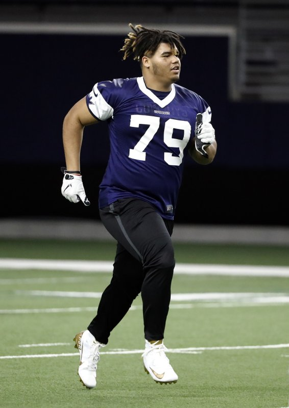 Dallas Cowboys rookie defensive tackle Trysten Hill jogs across the field at the end of the NFL football team's minicamp in Frisco, Texas, Friday, May 10, 2019. (AP Photo/Tony Gutierrez)