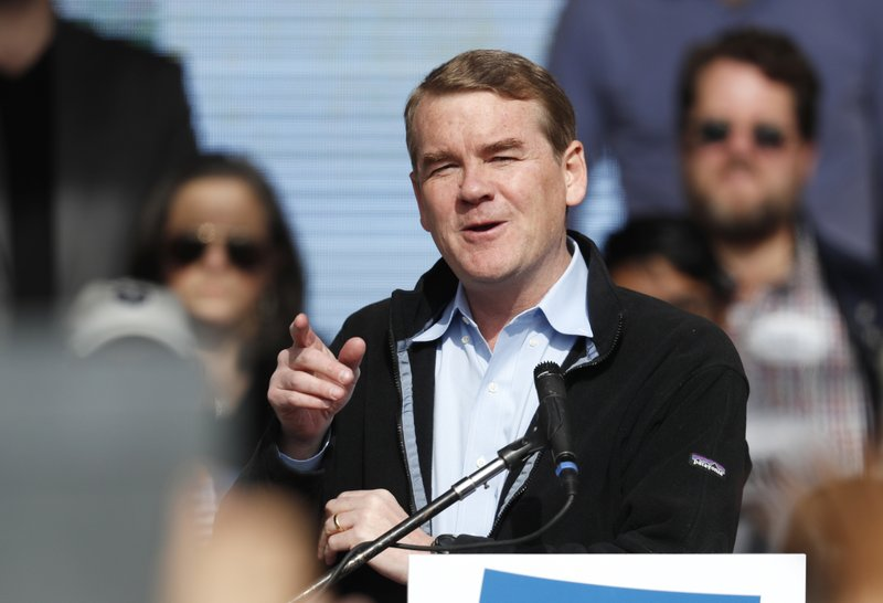 FILE - In this Oct. 24, 2018, file photo, U.S. Senator Michael Bennet, D-Colo., speaks before Senator Bernie Sanders during a rally with young voters on the campus of the University of Colorado in Boulder, Colo. (AP Photo/David Zalubowski, File)