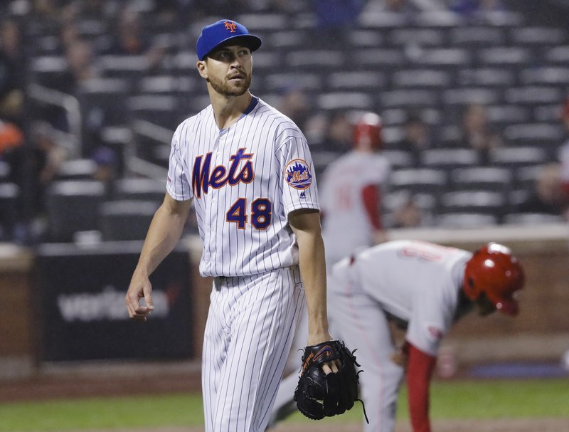 New York Mets starting pitcher Jacob deGrom leaves the field during the seventh inning of the team's baseball game against the Cincinnati Reds on Wednesday, May 1, 2019, in New York. (AP Photo/Frank Franklin II)