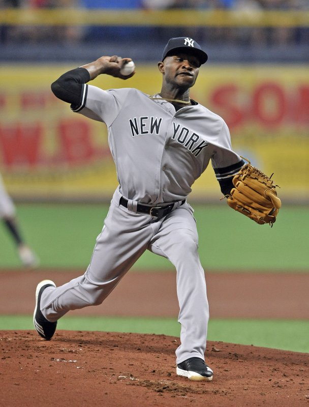 New York Yankees starter Domingo German pitches to a Tampa Bay Rays batter during the first inning of a baseball game Friday, May 10, 2019, in St. (AP Photo/Steve Nesius)