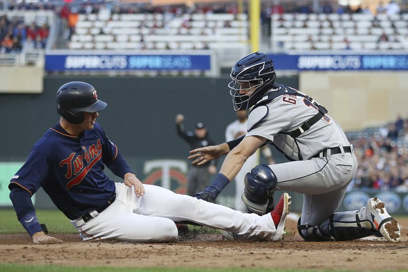 Minnesota Twins' Max Kepler is tagged out at home by Detroit Tigers catcher Grayson Greiner during the third inning of a baseball game Friday, May 10, 2019, in Minneapolis. (AP Photo/Stacy Bengs)