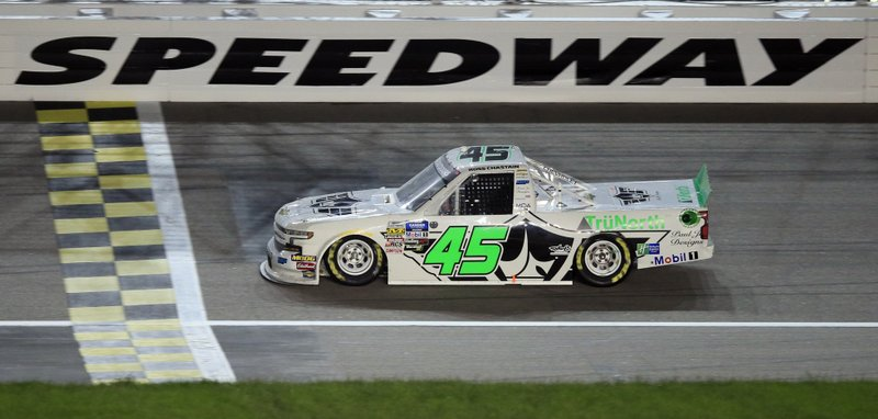 Ross Chastain crosses the finish line to win the NASCAR Truck Series auto race at Kansas Speedway in Kansas City, Kan. (AP Photo/Orlin Wagner)