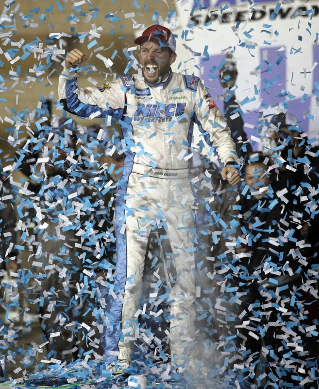 Ross Chastain celebrates in Victory Lane after winning the NASCAR Truck Series auto race at Kansas Speedway in Kansas City, Kan. (AP Photo/Orlin Wagner)