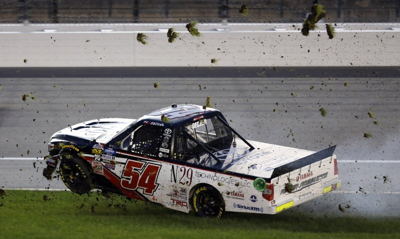 Driver Natalie Decker spins into the infield grass during the NASCAR Truck Series auto race at Kansas Speedway in Kansas City, Kan. (AP Photo/Colin E. Braley)