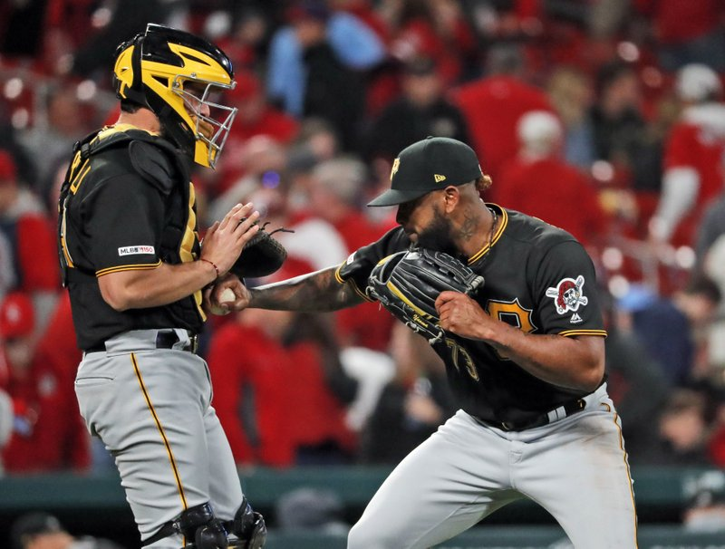 Pittsburgh Pirates relief pitcher Felipe Vazquez, right, and catcher Francisco Cervelli celebrate the team's 2-1 victory over the St. (AP Photo/Jeff Roberson)