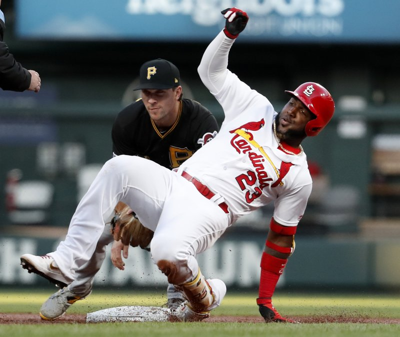 St. Louis Cardinals' Marcell Ozuna (23) advances to second after a single and a fielding error, as Pittsburgh Pirates second baseman Adam Frazier attempts a tag during the first inning of a baseball game Friday, May 10, 2019, in St. (AP Photo/Jeff Roberson)