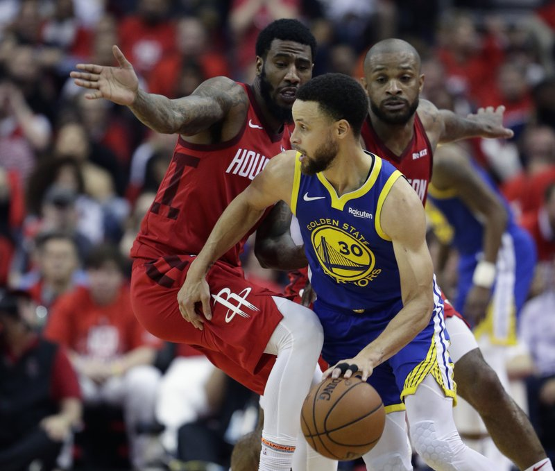 Golden State Warriors guard Stephen Curry (30) drives around Houston Rockets guard Iman Shumpert, left, and forward PJ Tucker during the second half in Game 6 of a second-round NBA basketball playoff series, Friday, May 10, 2019, in Houston. (AP Photo/Eric Gay)
