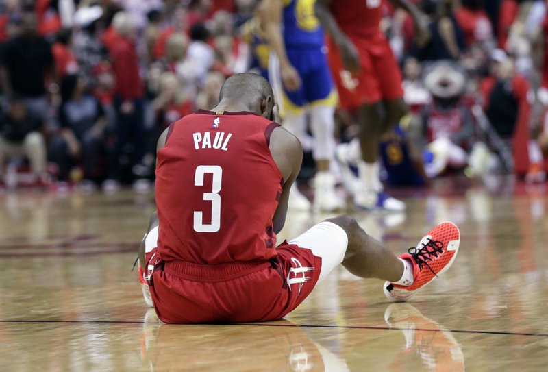 Houston Rockets guard Chris Paul sits on the court following a play during the second half in Game 6 of the team's second-round NBA basketball playoff series against the Golden State Warriors, Friday, May 10, 2019, in Houston. (AP Photo/Eric Gay)