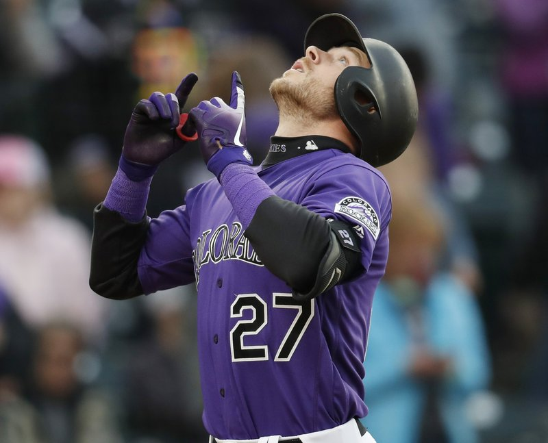 Colorado Rockies' Trevor Story gestures as he crosses home plate after hitting a two-run home run off San Diego Padres starting pitcher Eric Lauer during the third inning of a baseball game Friday, May 10, 2019, in Denver. (AP Photo/David Zalubowski)