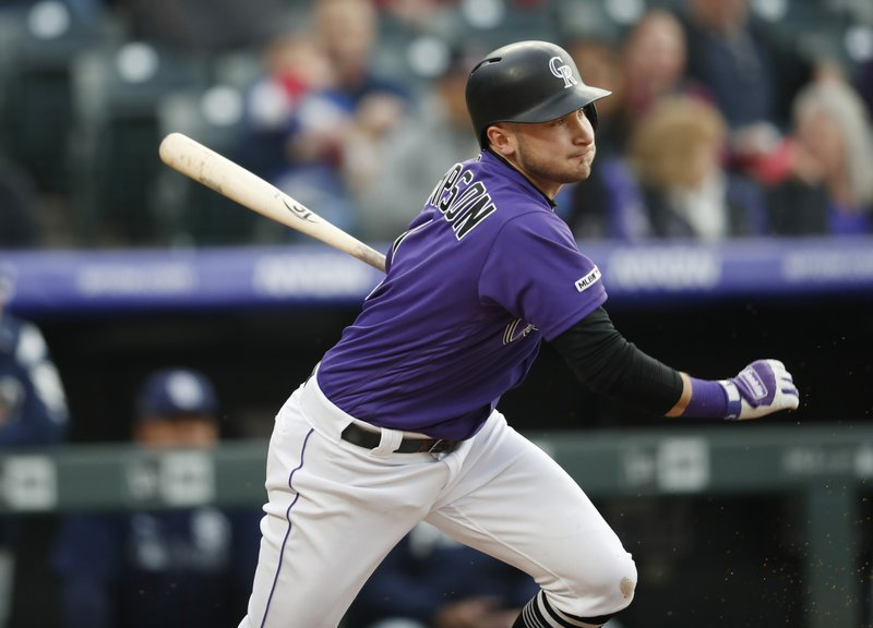 Colorado Rockies' Garrett Hampson watches his single off San Diego Padres starting pitcher Eric Lauer during the second inning of a baseball game Friday, May 10, 2019, in Denver. (AP Photo/David Zalubowski)
