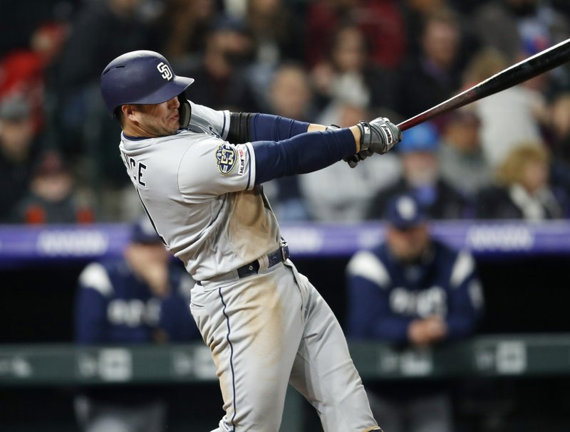 San Diego Padres' Ty France watches his RBI single off Colorado Rockies starting pitcher German Marquez during the fifth inning of a baseball game Friday, May 10, 2019, in Denver. (AP Photo/David Zalubowski)