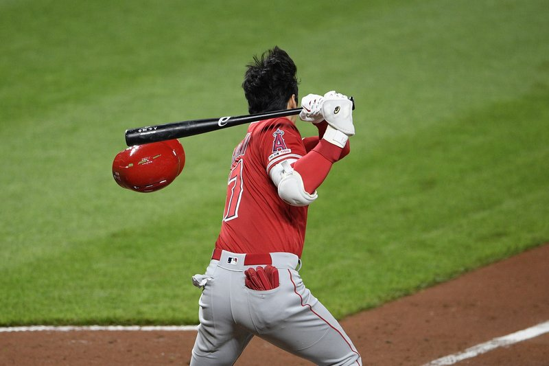 Los Angeles Angels' Shohei Ohtani, of Japan, loses his helmet as he grounds out during the sixth inning of a baseball game against the Baltimore Orioles, Friday, May 10, 2019, in Baltimore. (AP Photo/Nick Wass)