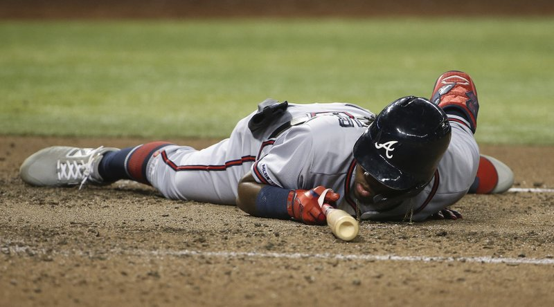 Atlanta Braves' Ronald Acuna Jr. stays on the ground after getting knocked down by an inside pitch by Arizona Diamondbacks starter Zack Greinke during the sixth inning of a baseball game Friday, May 10, 2019, in Phoenix. (AP Photo/Ross D. Franklin)
