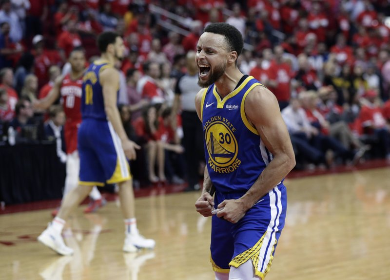 Golden State Warriors guard Stephen Curry (30) celebrates the team's win over the Houston Rockets in Game 6 of a second-round NBA basketball playoff series, Friday, May 10, 2019, in Houston. (AP Photo/Eric Gay)