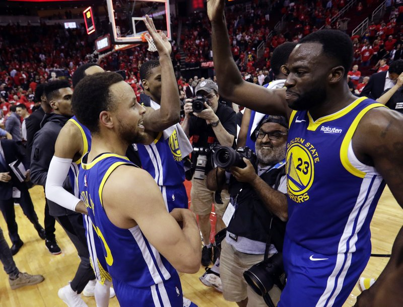 Golden State Warriors guard Stephen Curry, left, and forward Draymond Green (23) celebrate the team's win over the Houston Rockets in Game 6 of a second-round NBA basketball playoff series, Friday, May 10, 2019, in Houston. (AP Photo/Eric Gay)