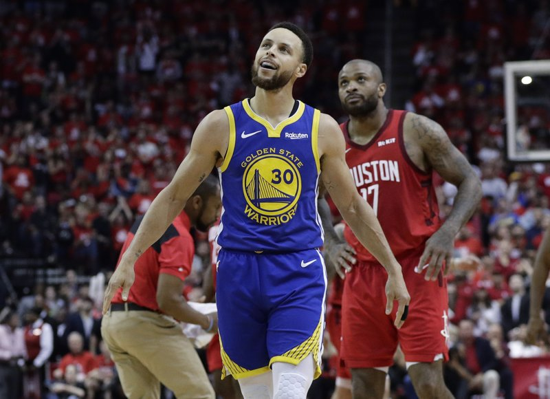 Golden State Warriors guard Stephen Curry (30) walks upcourt after a play during the second half in Game 6 of the team's second-round NBA basketball playoff series against the Houston Rockets, Friday, May 10, 2019, in Houston. (AP Photo/Eric Gay)