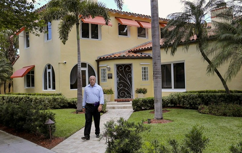 Richard Silverman is photographed outside his Palm View home, April, 23, 2019. Some Miami Beach Palm View neighborhood residents gathered at the home of Richard Silverman to discuss their fight to remove the historic designation of the South Beach neighborhood on Tuesday, April 23, 2019. (Carl Juste/Miami Herald via AP)