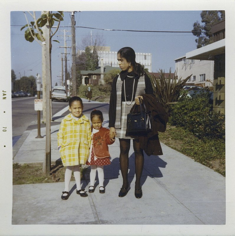 This January 1970 photo provided by the Kamala Harris campaign shows her, left, with her sister, Maya, and mother, Shyamala, outside their apartment in Berkeley, Calif. (Kamala Harris campaign via AP)