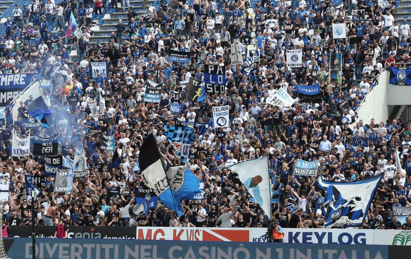 Atalanta's supporters waves flags and banners during a Serie A soccer between Atalanta and Genoa at the Mapei Stadium in Reggio Emilia, Italy, Saturday, May 11, 2019. (Paolo Magni/ANSA via AP)