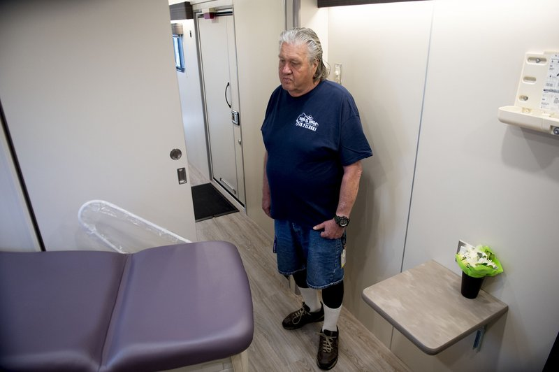 In this photo taken May 9, 2019, Jeff Williams, of the Fourth Street Clinic's consumer advisory board, tours their new mobile clinic in Salt Lake City. (Jeremy Harmon/The Salt Lake Tribune via AP)