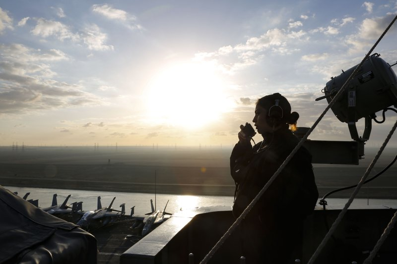 In this Thursday, May 9, 2019 photo released by the U.S. Navy, Operations Specialist Seaman Angelica Ruelas of Albuquerque, New Mexico, stands lookout while the Nimitz-class aircraft carrier USS Abraham Lincoln transits the Suez Canal in Egypt. (Mass Communication Specialist Seaman Dan Snow, U.S. Navy via AP)