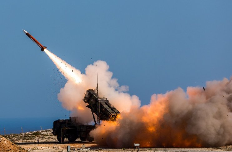 FILE - In this Nov. 8, 2017 photo provided by the U.S. Department of Defense, German soldiers assigned to Surface Air and Missile Defense Wing 1, fire the Patriot weapons system at the NATO Missile Firing Installation, in Chania, Greece. (Sebastian Apel/U.S. Department of Defense, via AP)