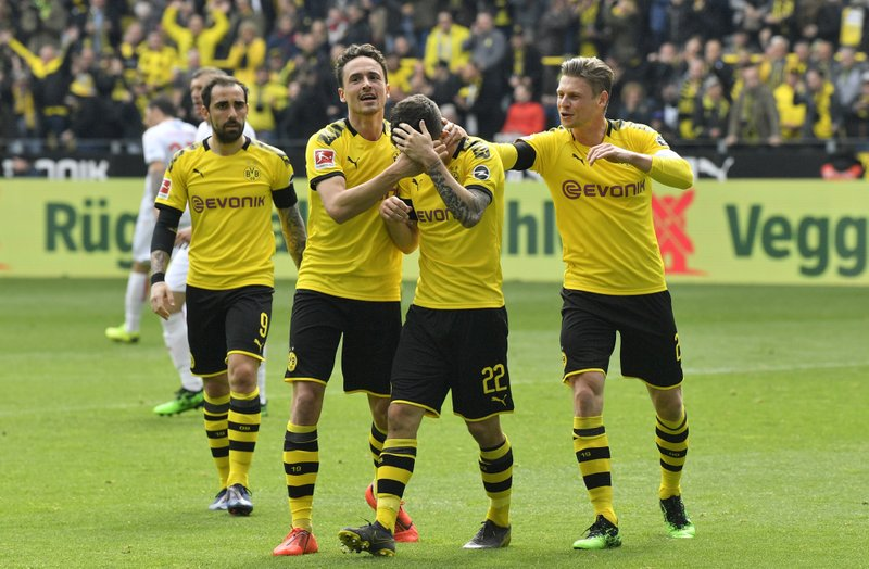 Dortmund's Christian Pulisic, 2nd right, reacts after scoring the opening goal during the German Bundesliga soccer match between Borussia Dortmund and Fortuna Duesseldorf in Dortmund, Germany, Saturday, May 11, 2019. (AP Photo/Martin Meissner)