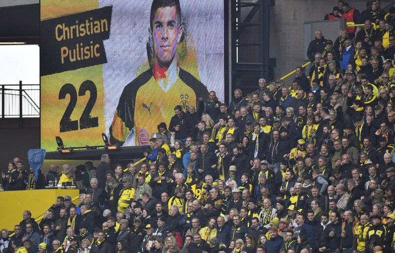 A video screen shows a picture of Dortmund's Christian Pulisic after he scored the opening goal during the German Bundesliga soccer match between Borussia Dortmund and Fortuna Duesseldorf in Dortmund, Germany, Saturday, May 11, 2019. (AP Photo/Martin Meissner)