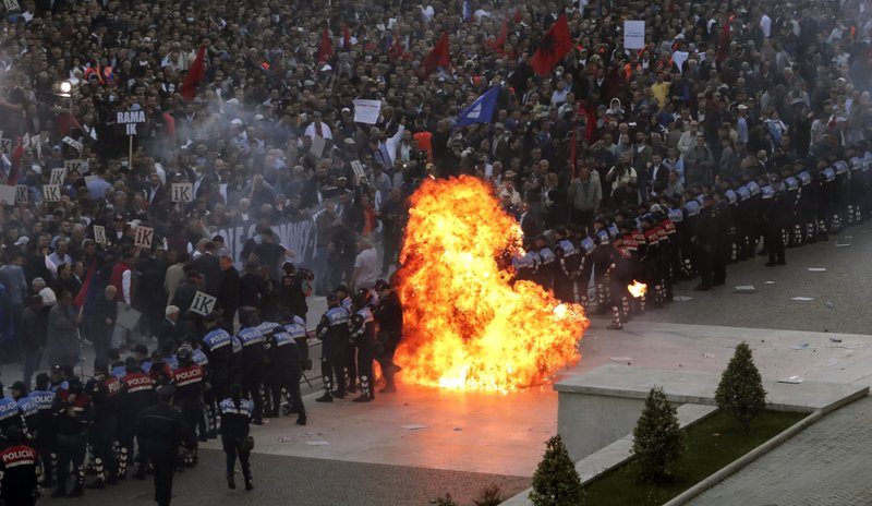 Protesters take part in an anti-government rally in Tirana, Saturday, May 11, 2019. Protesters demand the Socialist government to resign and call an early parliamentary election. (AP Photo/Hektor Pustina)