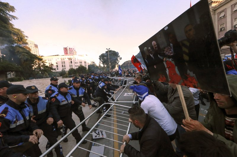 Protesters try to break a police cordon during an anti-government rally in Tirana, Saturday, May 11, 2019. (AP Photo/Hektor Pustina)