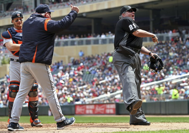 Detroit Tigers manager Ron Gardenhire, left, gets thrown out by plate umpire Hunter Wendelstedt, right, after protesting a walk call to load the bases for the Minnesota Twins in the third inning of a baseball game Saturday, May 11, 2019, in Minneapolis. (AP Photo/Jim Mone)