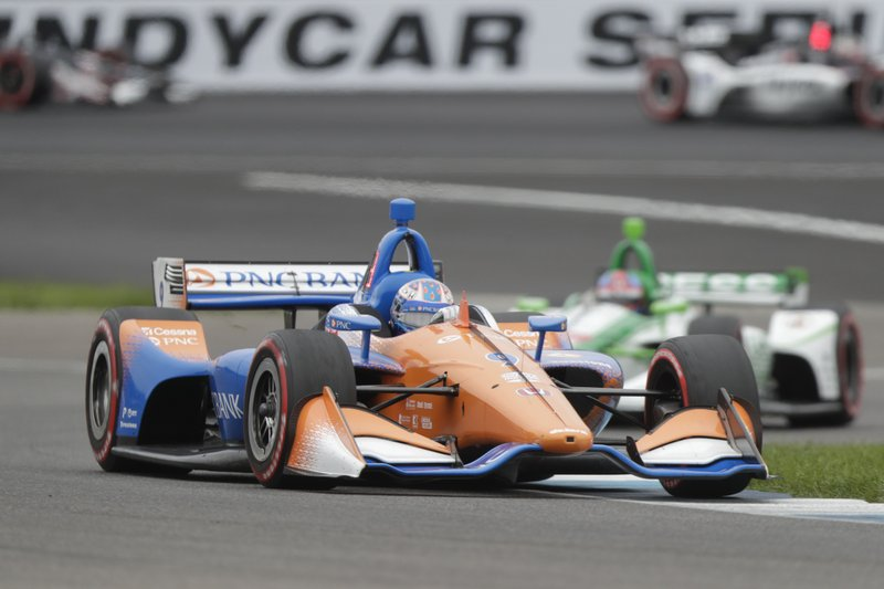 Scott Dixon, of New Zealand, drives through a turn during the Indy GP IndyCar auto race at Indianapolis Motor Speedway, Saturday, May 11, 2019 in Indianapolis. (AP Photo/Michael Conroy)
