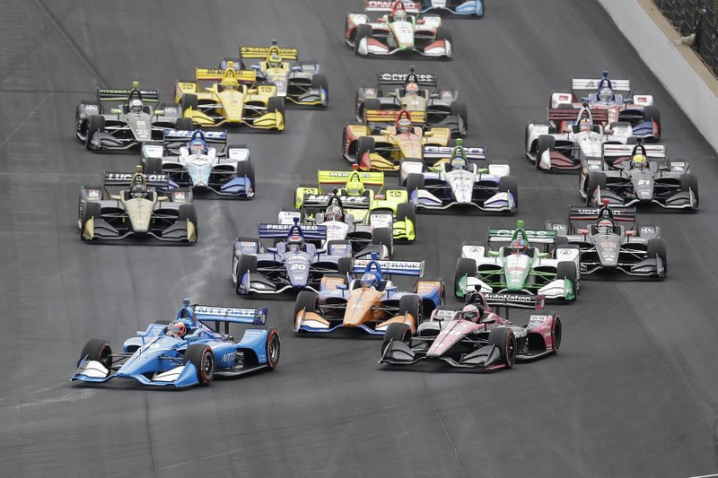 Felix Rosenqvist, of Sweden, leads the field into turn one at the start of the Indy GP IndyCar auto race at Indianapolis Motor Speedway, Saturday, May 11, 2019 in Indianapolis. (AP Photo/Darron Cummings)