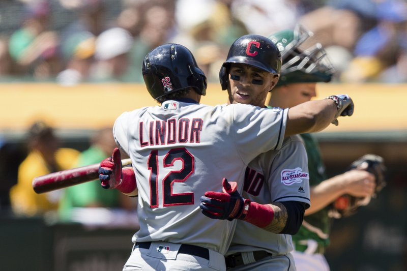 Cleveland Indians' Leonys Martin, right, celebrates with Francisco Lindor (12) after hitting a solo home run against the Oakland Athletics in the fifth inning of a baseball game Saturday, May 11, 2019, in Oakland, Calif. (AP Photo/John Hefti)