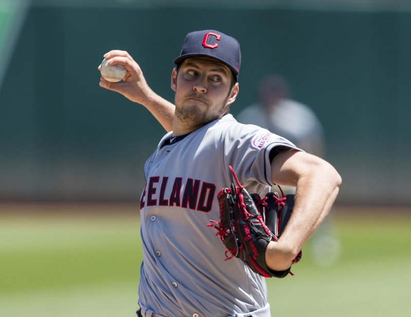 Cleveland Indians starting pitcher Trevor Bauer throws against the Oakland Athletics in the first inning of a baseball game Saturday, May 11, 2019, in Oakland, Calif. (AP Photo/John Hefti)